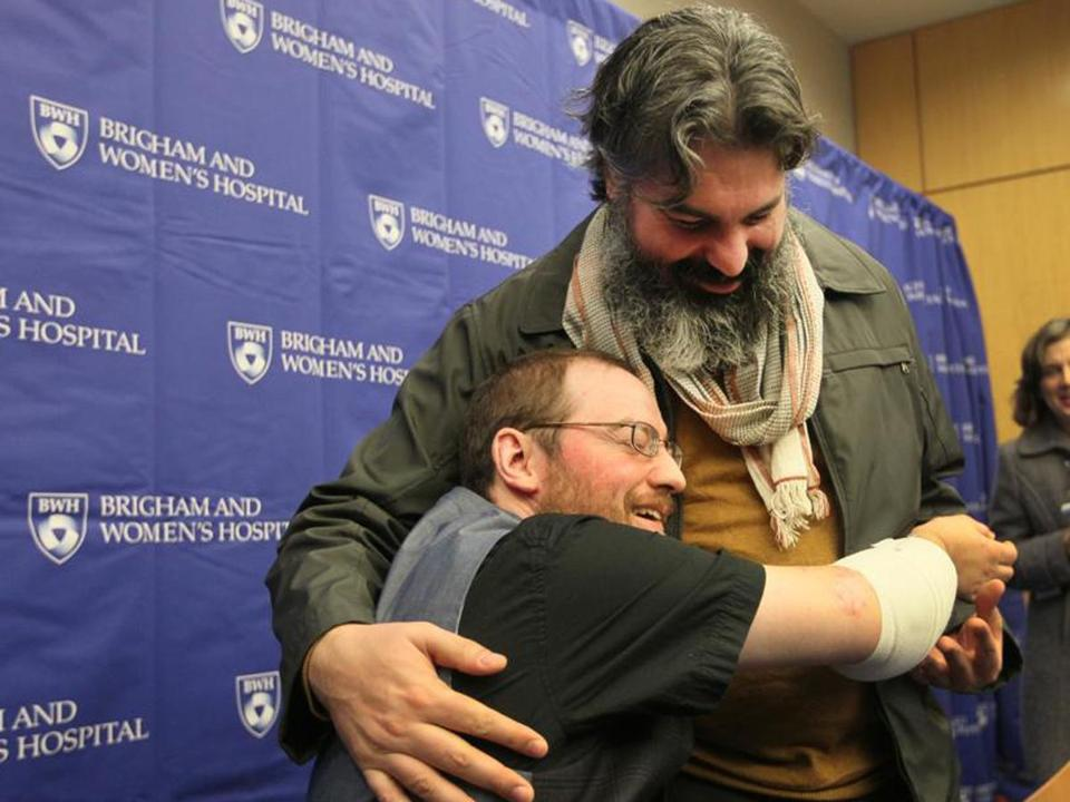 Will Lautzenheiser showed how he can use his newly transplanted arms to hug his partner, Angel Gonzalez.
