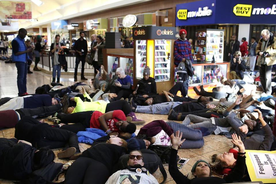 People protesting a grand jury's decision not to indict the police officer who fatally shot Michael Brown in Ferguson, Mo. temporarily shut down the Galleria mall in Richmond Heights 10 miles away.