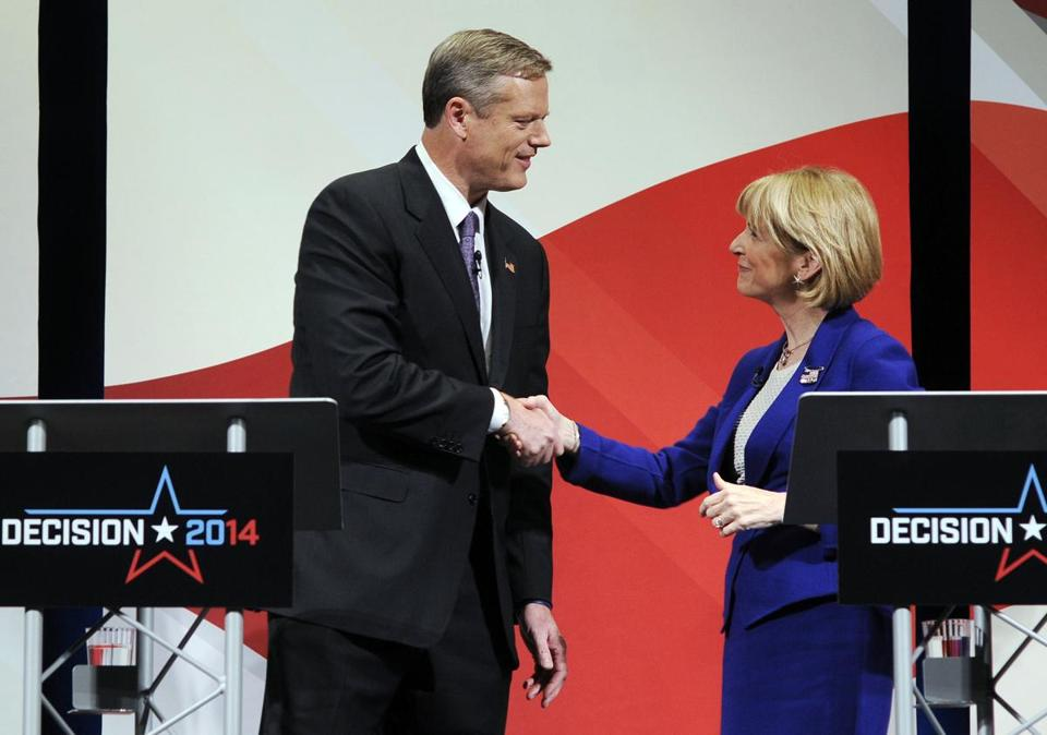 Charlie Baker and Martha Coakley shook hands before their debate in Worcester. Outside groups spent millions of dollars in the gubernatorial campaign.