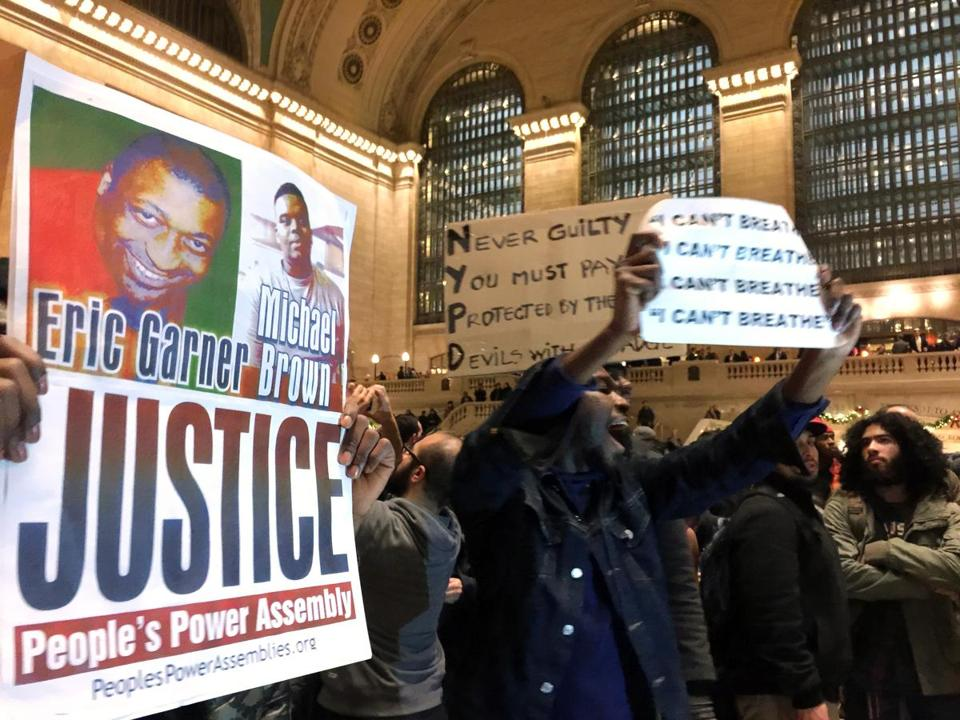 Protesters gathered in Grand Central Terminal after it was announced that the police officer involved in the death of Eric Garner was not indicted.
