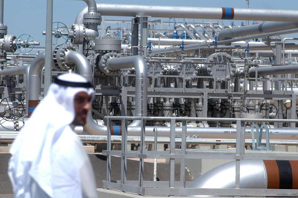 A worker walks at an oil facility in a Kuwait oilfield in 2005.