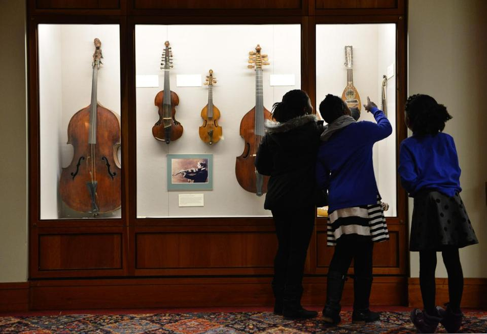 At Symphony Hall,  (from left) Jernyida George, 13, and STEP students Trinity Dickson, 9, and Angelina Wallace, 9, look over various period instruments.