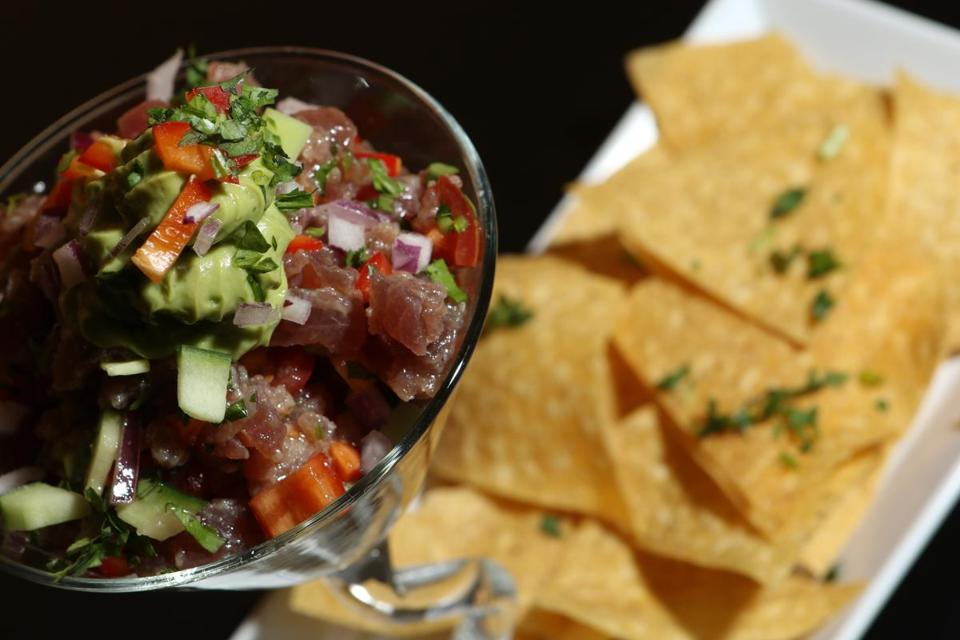 Tuna ceviche is a featured dish on the menu, which also includes oysters and tapanade.