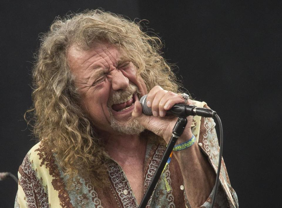 Robert Plant performs on the Pyramid main stage at Glastonbury music festival, England, Saturday, June 28, 2014. More than 175,000 are expected to have arrived at Worthy Farm in Pilton to watch hundreds of acts amongst headliners, Arcade Fire, Metallica and Kasabian.(Photo by Joel Ryan/Invision/AP) 14bestalbumsreed 21mature