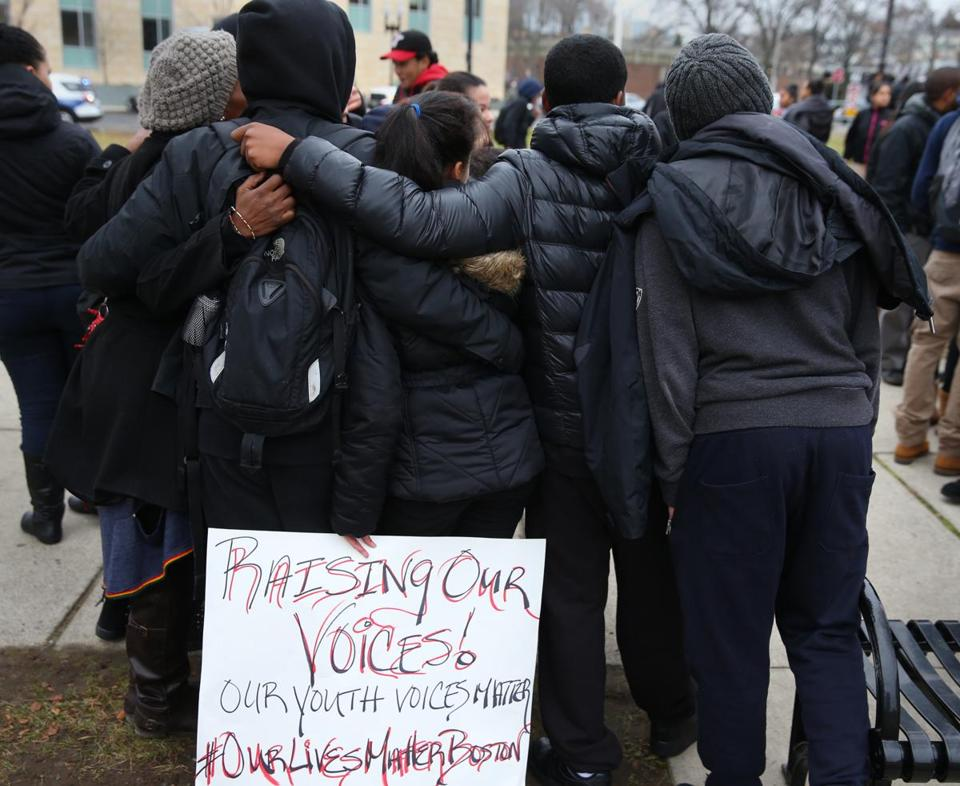 'Black Lives Matter' protesters gather in a park near near Dudley Square Tuesday.