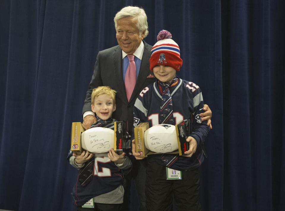 Danny Keefe (left) and his friend Tommy Cooney (right) met Patriots owner Bob Kraft at a game against the Bills in 2013 after Cooney's story of defending Keefe went viral.