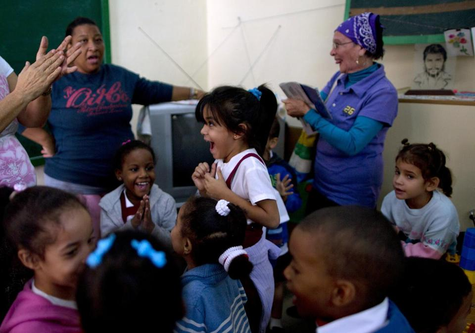 Students and teachers celebrated after listening to a nationally broadcast speech by Cuba's President Raul Castro about the start of talks to normalize diplomatic relations with the US.