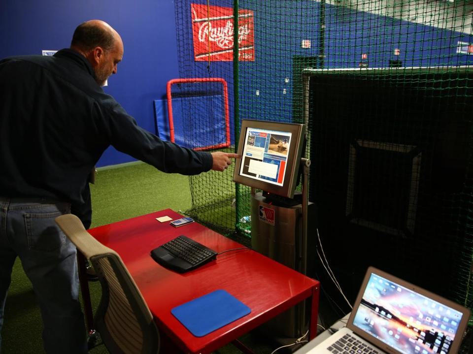 Dennis Clemens demonstrated SmartKage features at SmartSports headquarters in Tyngsborough.