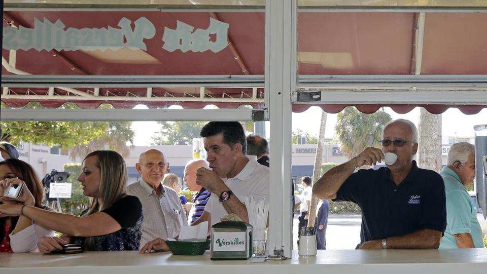 Cuban-American Jose Feliu (right) sipped a Cuban coffee as he prepared to go to work in the Little Havana area of Miami on Dec. 18.