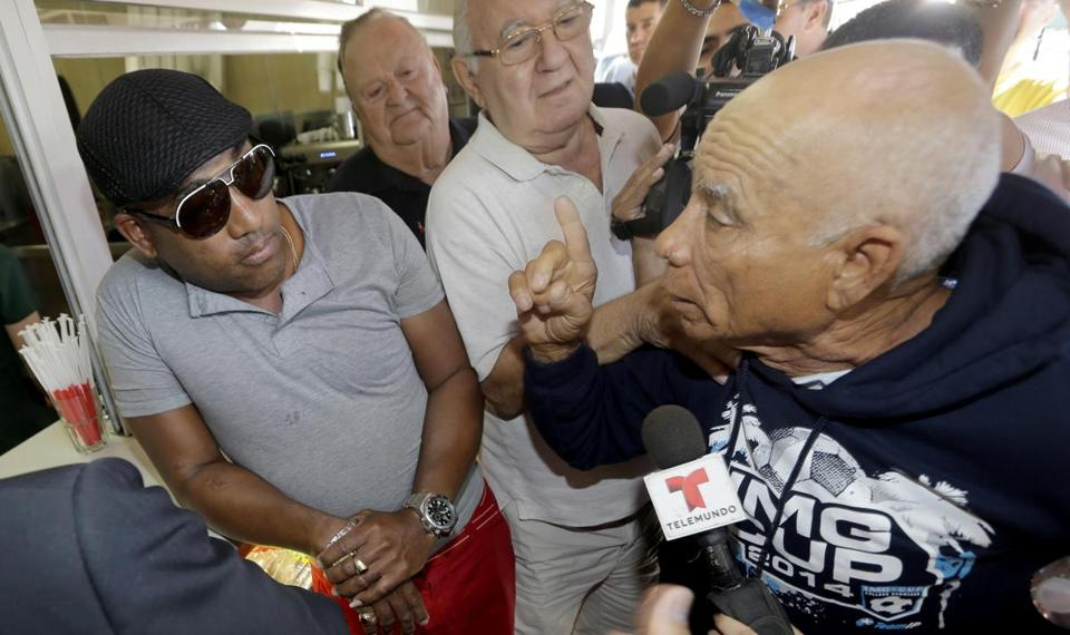 Angel Perez, who supports President Obama, listened to former prisoner Rafael Dominguez disagree with the president's  action in Miami on Thursday.