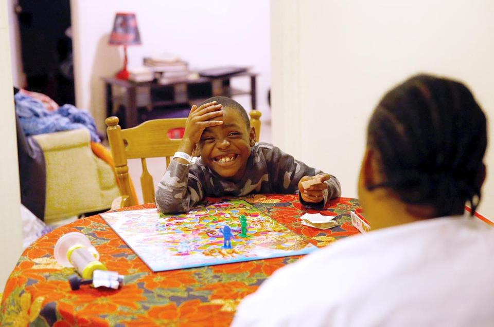 Jameal smiled as he defeated his father at the game Candy Land at their home.