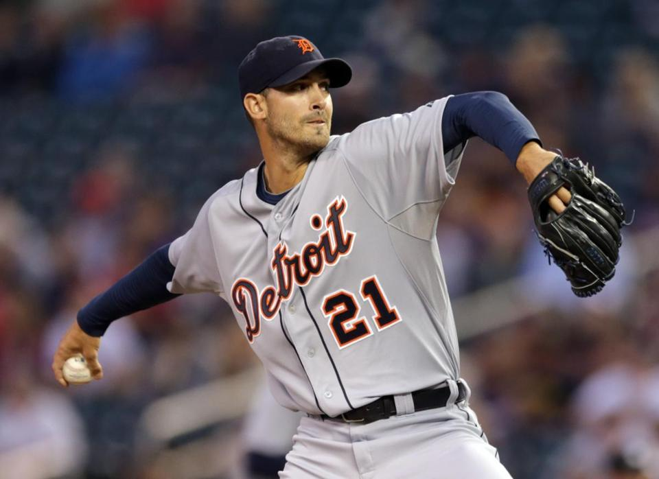 Detroit Tigers pitcher Rick Porcello throws against the Minnesota Twins in the first inning of a baseball game, Tuesday, Sept. 16, 2014, in Minneapolis. (AP Photo/Jim Mone)