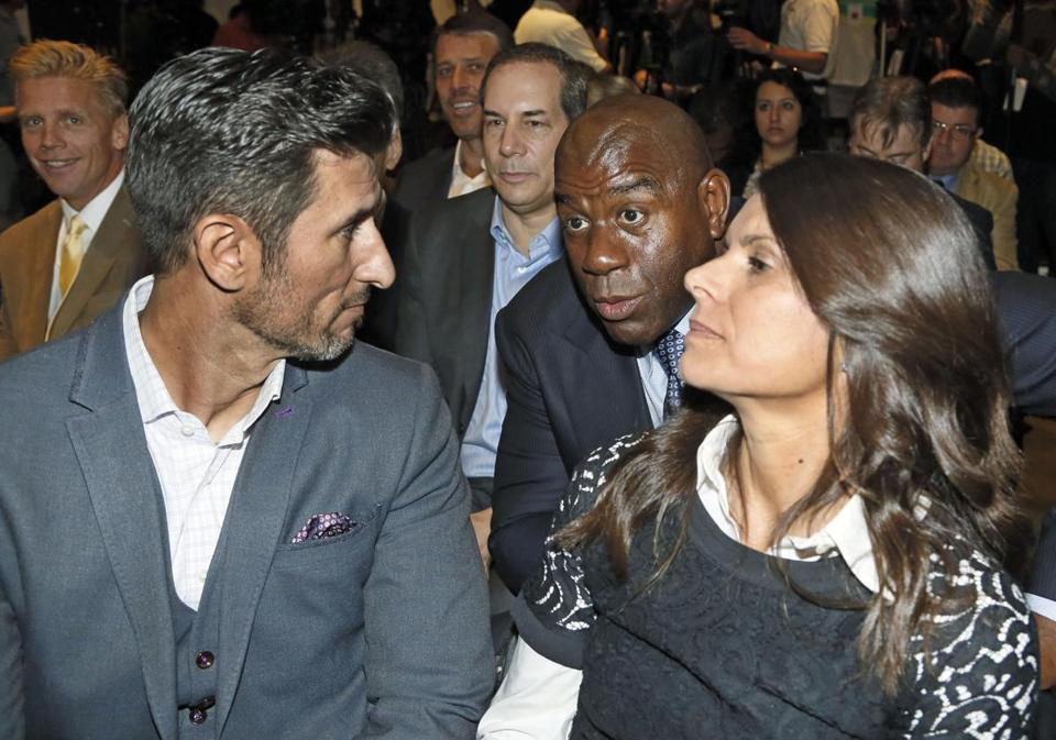 Mia Hamm (right), Magic Johnson (center), and Nomar Garciaparra (left) at a news conference on Oct. 30 in Los Angeles.