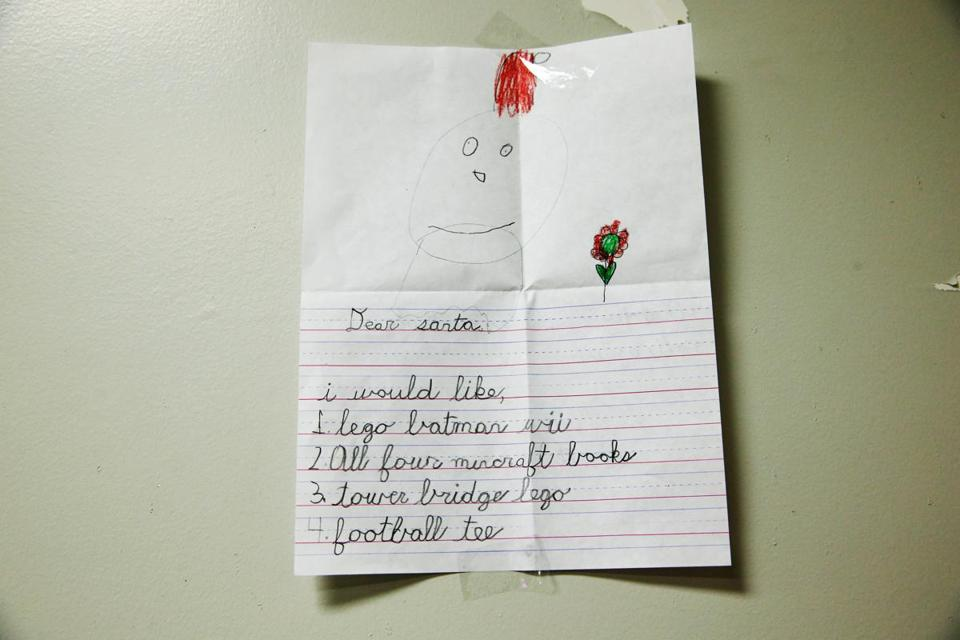 A letter to Santa hangs on a wall at the Post Office annex in South Boston.