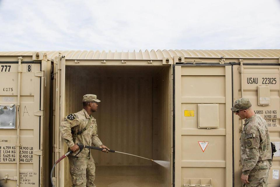 US soldiers cleaned a shipping container in preparation for leaving forward operating base Gamberi in the Laghman province of Afghanistan.