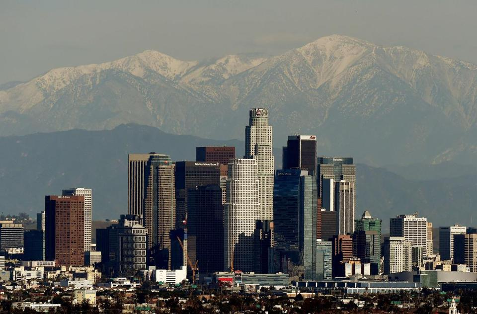 The Los Angeles city skyline in front of the San Gabriel Mountains on Dec. 31, 2014.