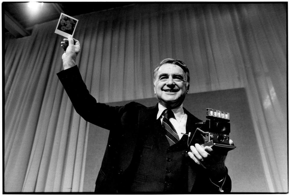 Polaroid Images for a January 25 Magazine story Boston Globe Staff File Photo, Undated. Dr. Edwin H. Land, Chairman of the Board and Director of Research of Polaroid Corporation, holds up a color photograph he took moments earlier with ta new Polaroid SX-70 film that produces a fully developed print in about one minute. Dr. Land demonstrated the super fast SX-70 film at Polaroid's annual shareholders' meeting. This is one of the most important new developments we have ever made, and we'r working vigorously to complete the procedures for introduction, he said.