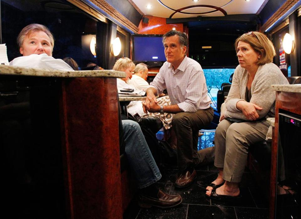 Mitt Romney listened to a conference call with senior adviser Eric Fehrnstrom, left, and campaign manager Beth Myers on his campaign bus enroute to a rally in Pompano Beach, Fla. on Jan. 29, 2012.