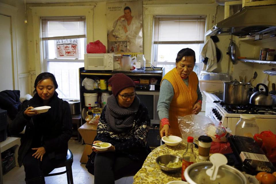 Activists Ruodi Duan, left, and Betty Fong work to protect tenants such a Pei Ying Yu, right, at 103 Hudson St.