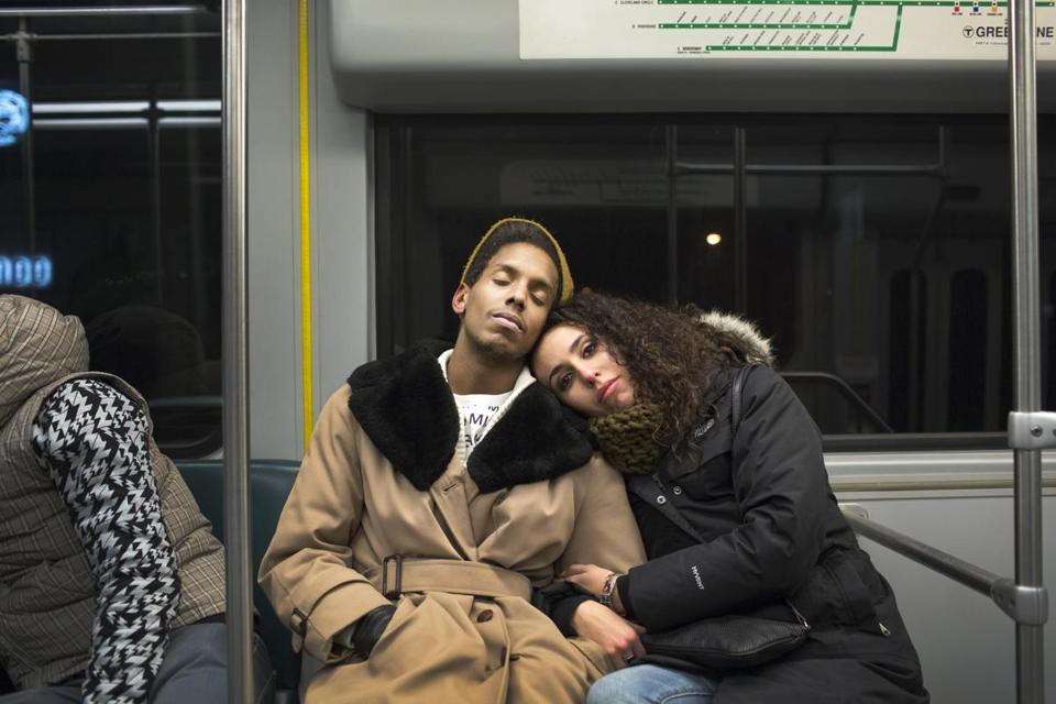 Jonathan Batista and Maria Alvarez rode the train at night near the Harvard Ave. stop on the Green Line.