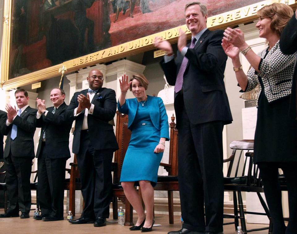 Maura Healey (center) acknowleged the crowd after being sworn in as Massachusetts Attorney General.