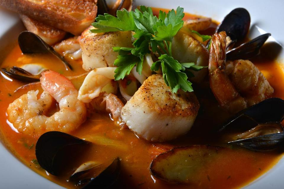Cala's fish stew, with shrimp, mussels, scallops, and potatoes in a lobster saffron broth.