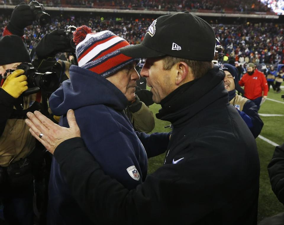Bill Belichick (left) and Ravens coach John Harbaugh met after their AFC Divisional playoff game Jan. 10 at Gillette Stadium.