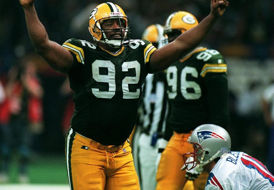 New Orleans, LA--1/26/97--Packers #92 Reggie White reacts after sacking Patriots Drew Bledsoe (lower right on ground). Super Bowl