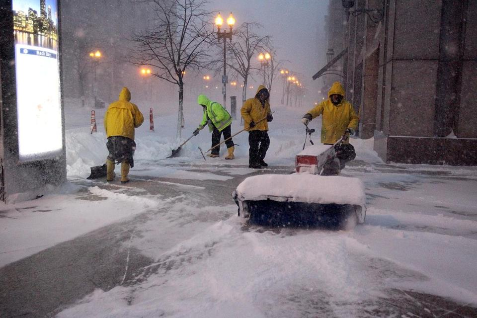 Crews cleared snow on Boylston Street early Tuesday.