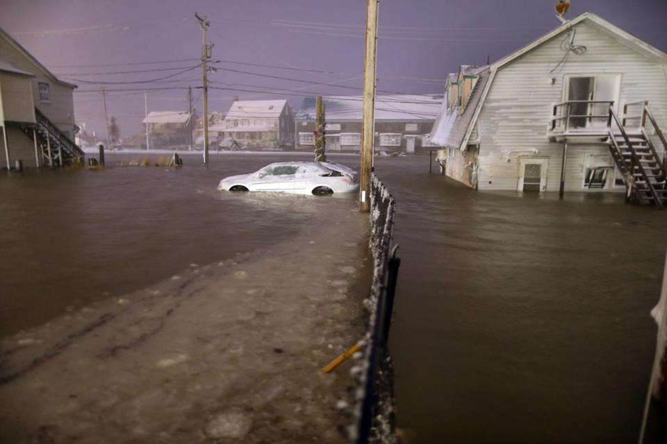 At the height of high tide Tuesday night, homes and businesses were surrounded by the ocean flooding over the seawall in the Brant Rock section of Marshfield.
