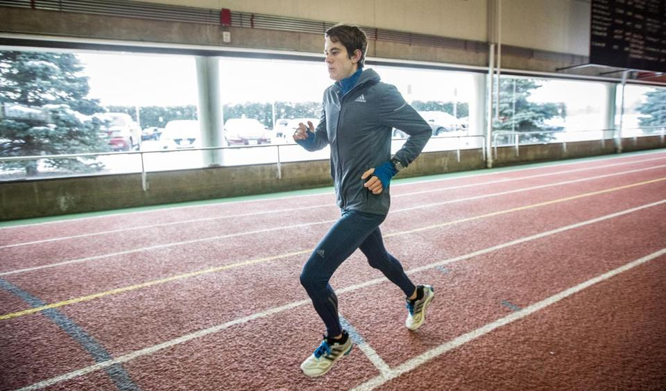 At Harvard's Gordon Indoor Track, marathoner Brian Harvey runs with his latest Garmin GPS watch (right) keeping track of his time and mileage — and his pace and his elevation.