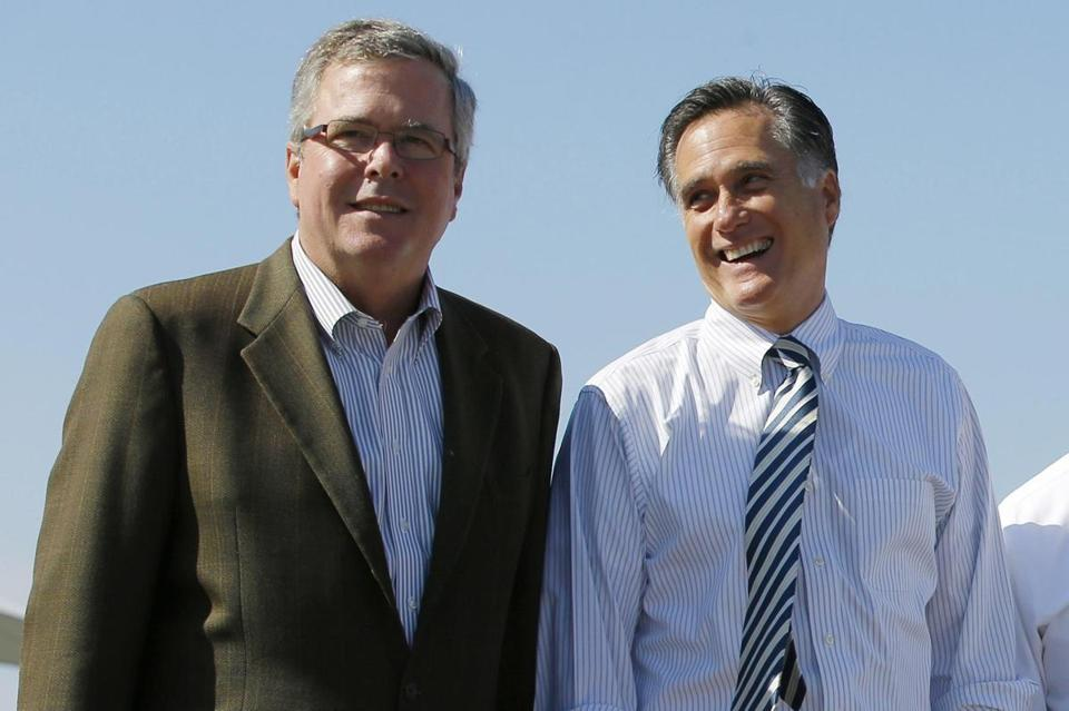 Former Florida Governor Jeb Bush (left) and former Massachusetts Governor Mitt Romney posed for a photograph together after a 2012 Romney for President campaign rally.