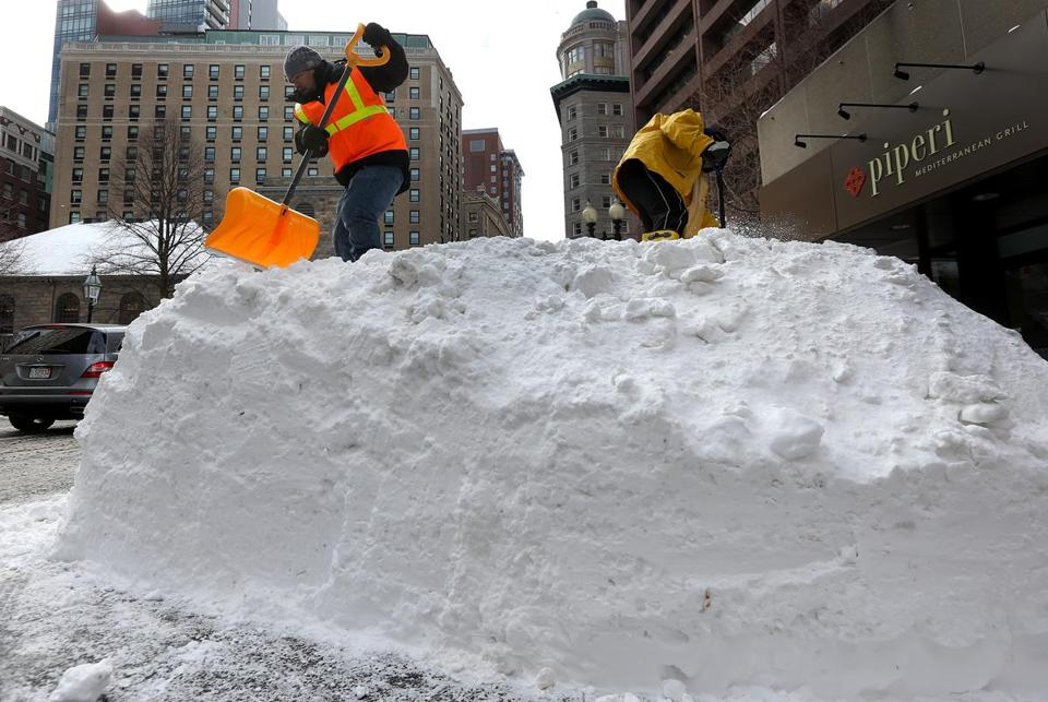 Boston should be able to deal with the costs in the current year, the Moody's report found. Pictured: Snowbanks were cleared near Tremont Street in Boston in late January.