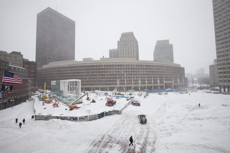 Crews removed snow from City Hall Plaza on Monday ahead of planned victory parade for the Patriots.