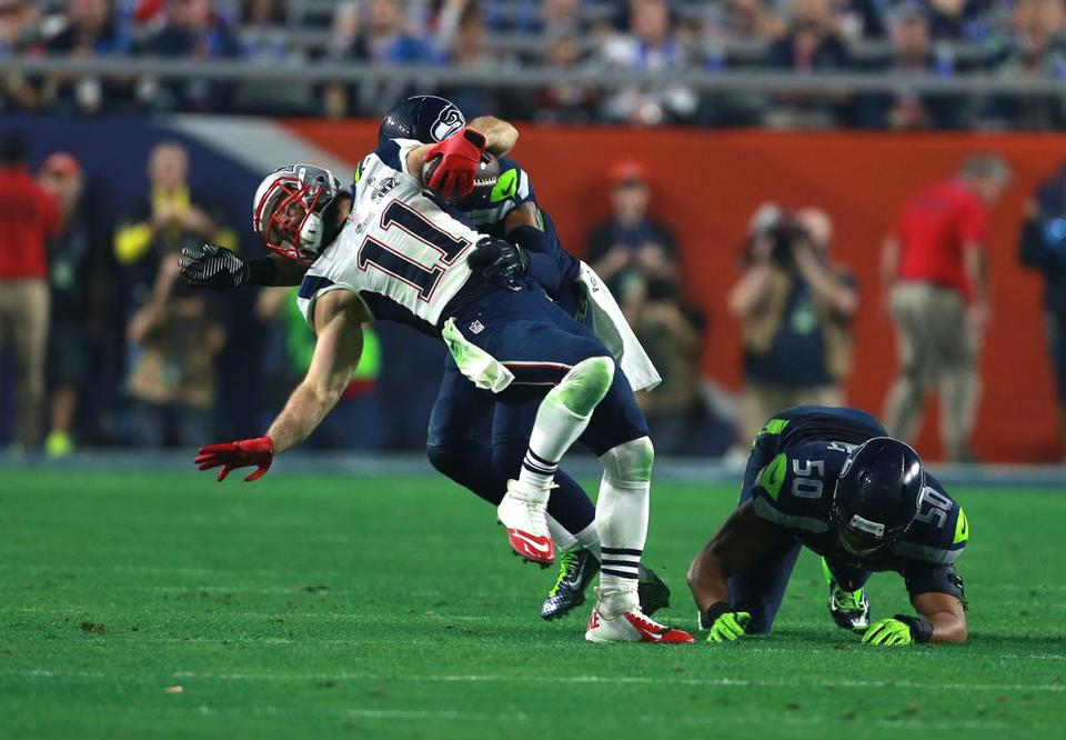 Julian Edelman didn't come off the field until several plays after absorbing a head-to-head hit from Kam Chancellor the third quarter of the Super Bowl.