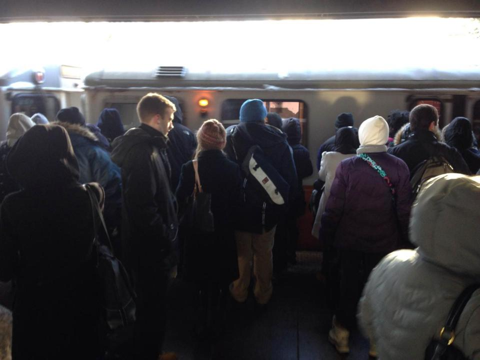 Commuters waited for a train at the Sullivan Square MBTA station on Tuesday.