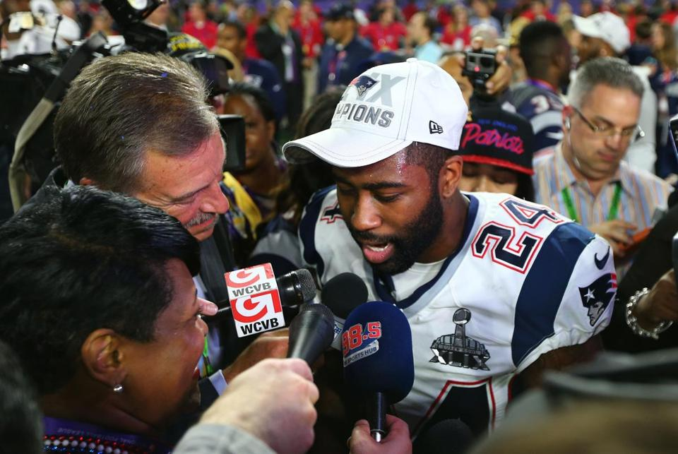 GLENDALE, AZ - FEBRUARY 01: Darrelle Revis #24 of the New England Patriots talks to the media after defeating the Seattle Seahawks 28-24 to win Super Bowl XLIX at University of Phoenix Stadium on February 1, 2015 in Glendale, Arizona. (Photo by Elsa/Getty Images)