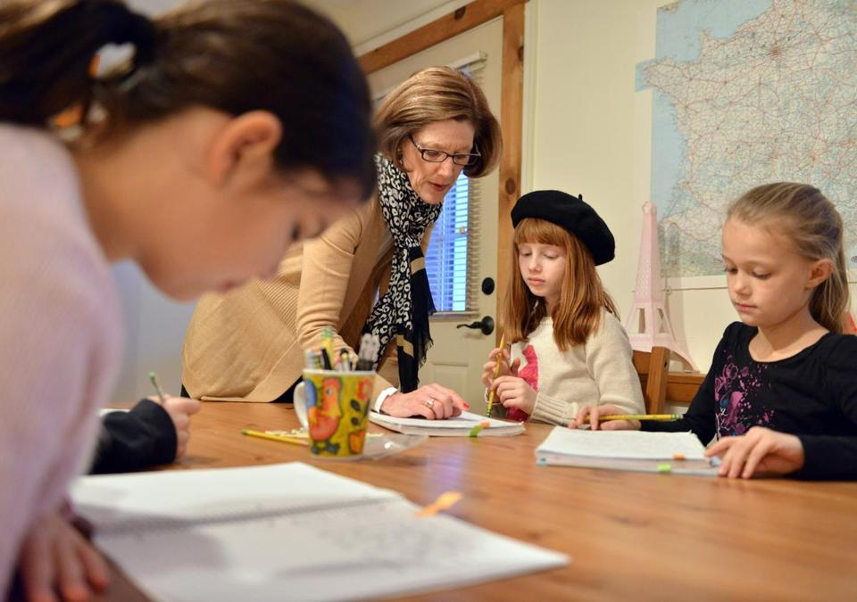French in Acton director Cynthia Edelman guided students through a language lesson.