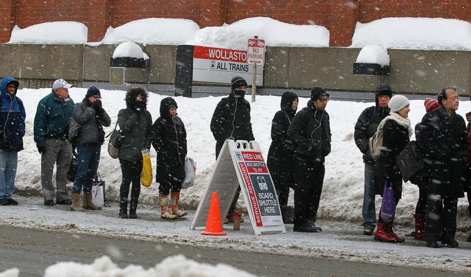 The Red Line's woes had riders lined up for shuttle buses Wednesday at a Quincy T station.