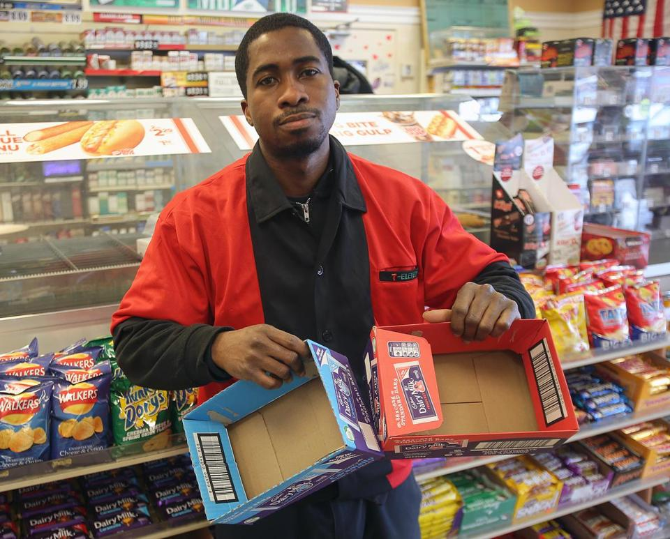 At a 7-Eleven in Quincy, Charles Abakah displayed empty Cadbury boxes.
