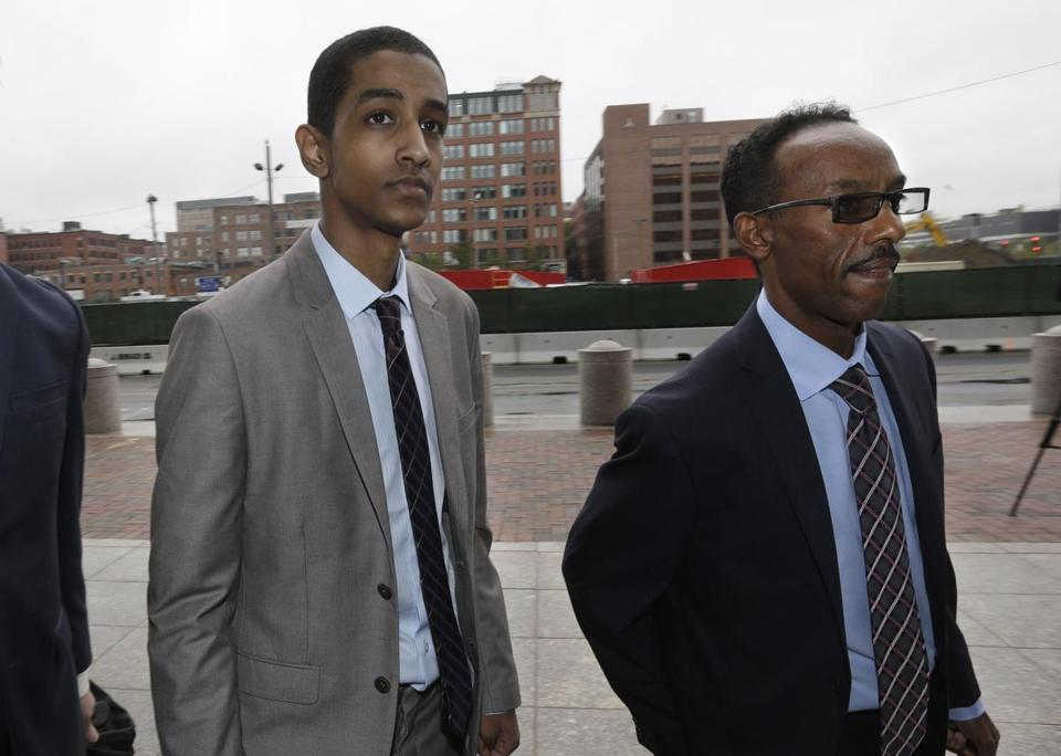 Robel Phillipos (left with his lawyer) was a friend of Tsarnaev's at Rindge.