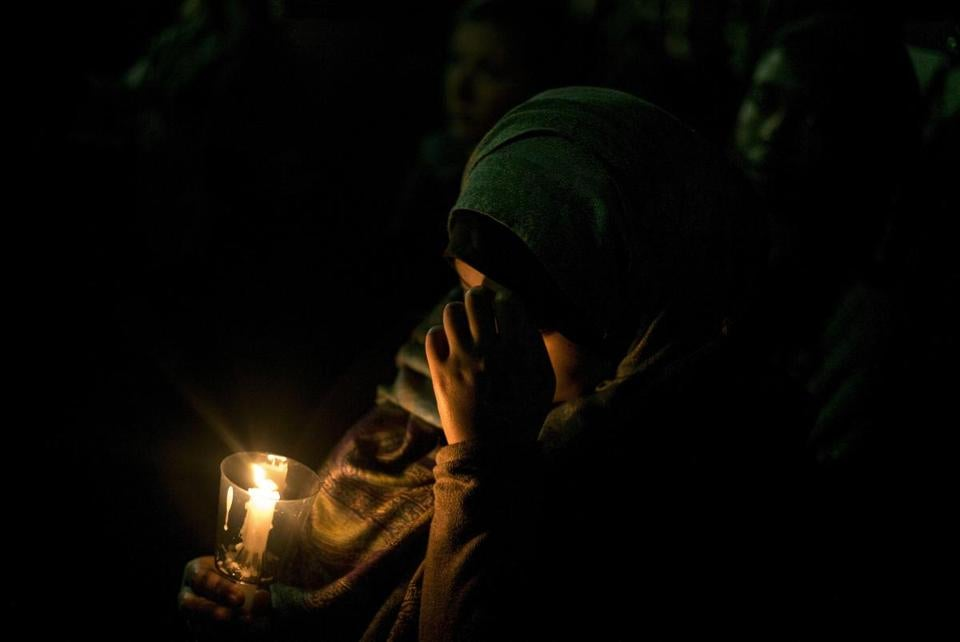 A woman held a candle during a vigil at the University of North Carolina after the fatal shootings of three Muslims in Chapel Hill.