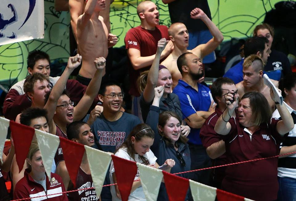 The Westford Academy contingent cheered after Jack Koravos won the 100 butterfly during the Division 1 championships.
