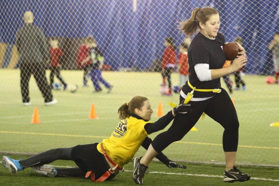 "Grace Posluszny tried to ""tackle"" Jodi Brown during a an indoor flag football game held  game at Turf Time in Tewksbury."