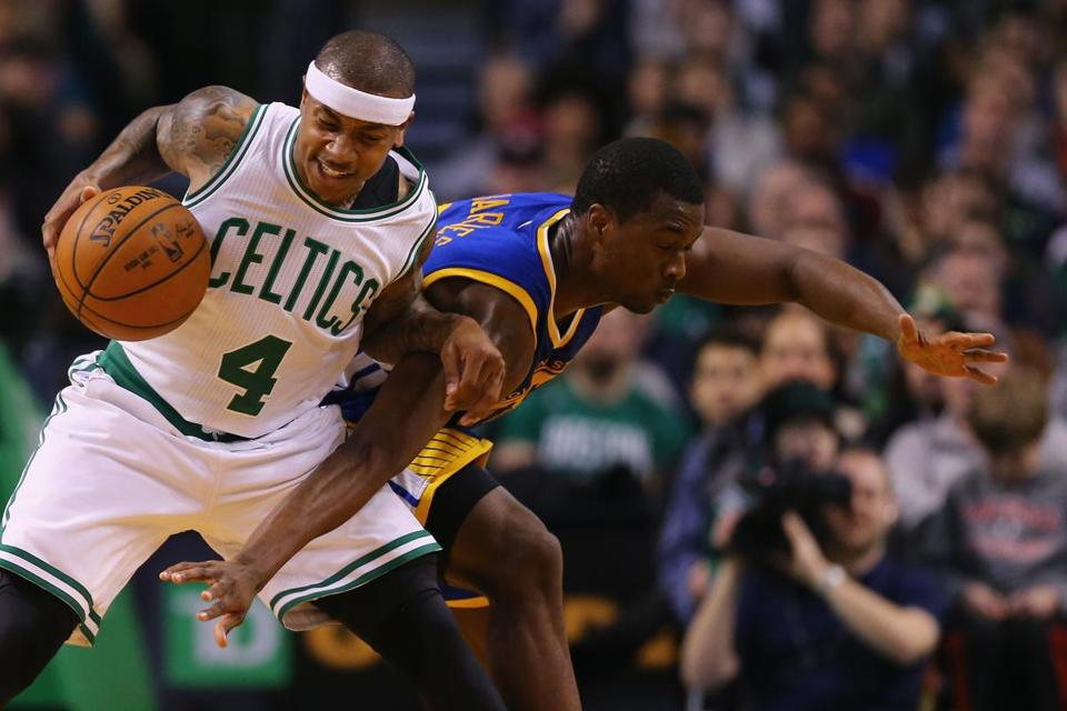 Boston's Isaiah Thomas battled Golden State's Harrison Barnes for the basketball during the second quarter.