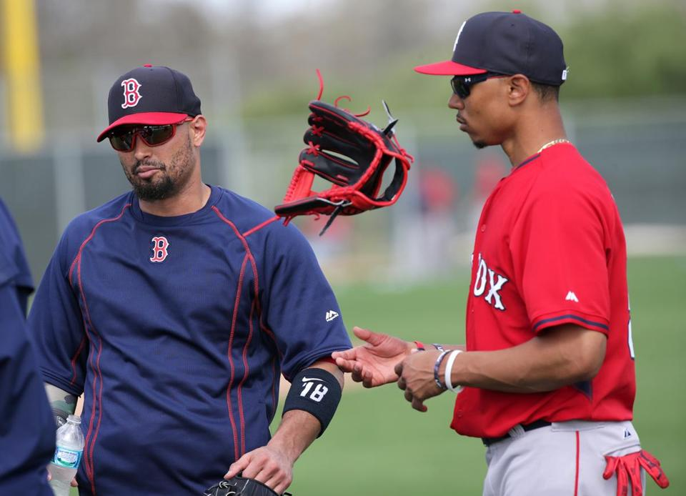 Shane Victorino has worked with fellow outfielder Mookie Betts throughout spring camp.