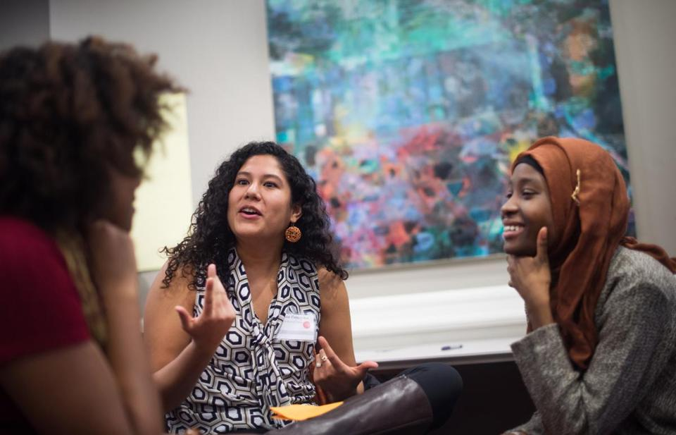 Jasmine Fernandez, a senior at Harvard University, left, attends an open dialogue session for students and administers during a conference for low-income, first generation ivy league students at Brown University, Saturday, Feb. 28, 2015. Kujegi Camara, a junior at Princeton University is seen at right. (Gretchen Ertl for The Boston Globe)