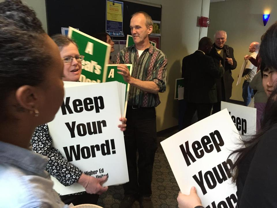 "Workers showed their frustration Wednesday by marching across the UMass Boston campus to Chancellor J. Keith Motley's office, chanting and waving signs that read ""a deal's a deal."" (Laura Krantz/Globe Staff)"