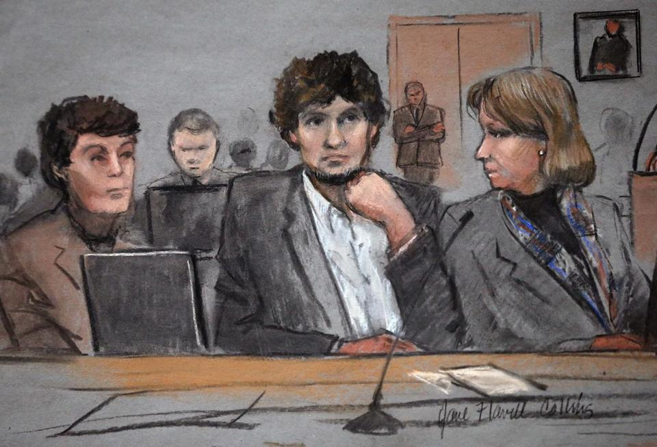 A courtroom sketch depicts Dzhokhar Tsarnaev (center) during his trial on Thursday between defense attorneys Miriam Conrad (left) and Judy Clarke (right).