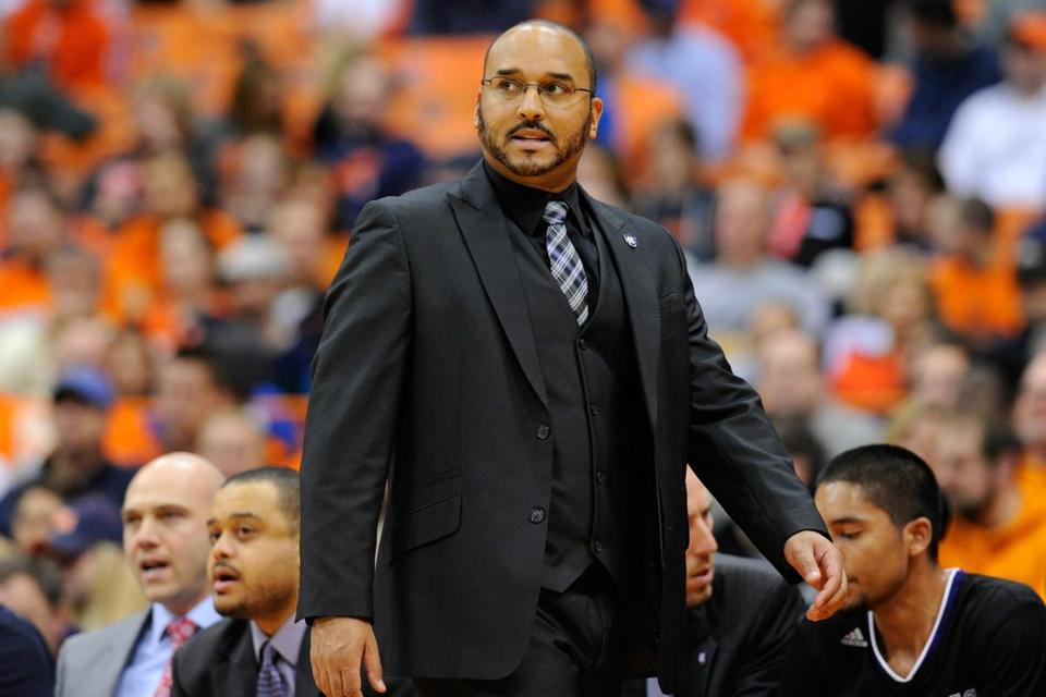 SYRACUSE, NY - NOVEMBER 28: Head coach Milan Brown of the Holy Cross Crusaders looks on against the Syracuse Orange during the first half at the Carrier Dome on November 28, 2014 in Syracuse, New York. (Photo by Rich Barnes/Getty Images)